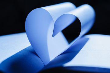 background with heart-shaped paper