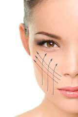 Facelift anti-aging treatment on woman face skin