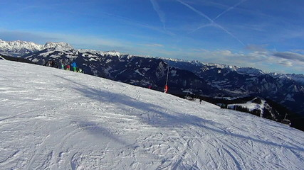 Ski slope and mountains in sunny day, pov, slow motion