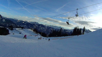 Ski lift chairs on hillside, slow motion, pov, Alps