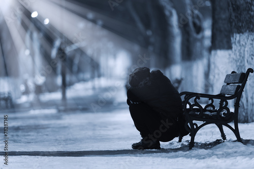 Depressed woman in front of a bench - 78287145