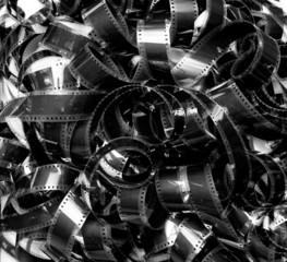 Unrolled heap 35mm movie filmstrip carpet vintage black and whit