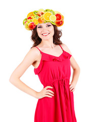 Beautiful young woman with fruit wig isolated on white