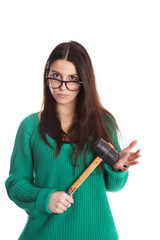 girl with hammer, green sweater and glasses. Isolated on white