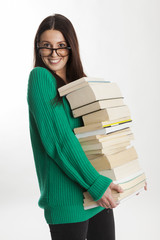 student female with glasses holds books and smile.