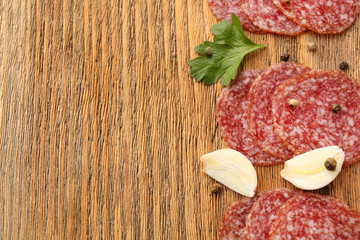 Slices of salami with cloves of garlic and spices