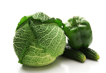 Savoy cabbage, cucumber and green pepper isolated on white