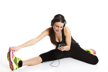 lady doing streching with headphones mobile. Isolated on white