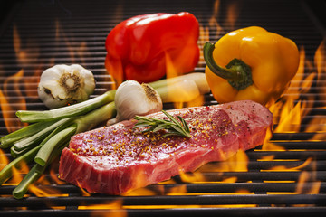 Steak and Vegetables on a Hot Flaming Grill