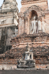 temple ruin and the sculptures of Buddha