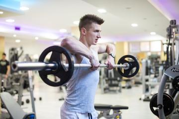 Bodybuilder Men Doing Exercises with Dumbbells in Gym