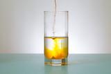 pours into glass yellow powder