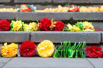 bright paper flowers on the steps of