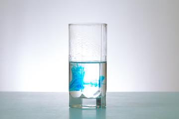 in glass of water soluble blue dye