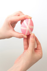 Easter egg with white stripes