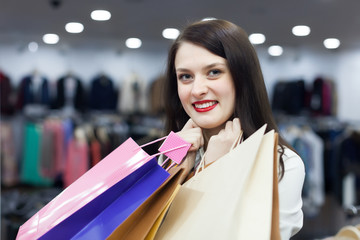 Happy brunette girl with shopping bags