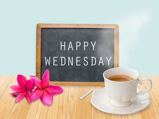 Happy Wednesday on chalkboard with coffee