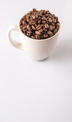 Roasted coffee bean in white mug