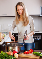 girl with ladle cooking soup