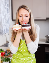 housewife in apron with cakes