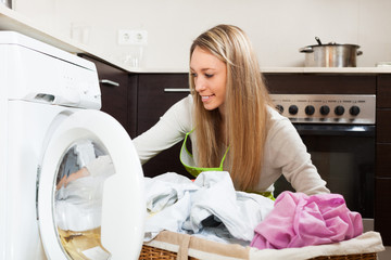 Smiling  woman  near washing machine