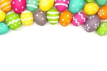 Colorful Easter egg top border against white