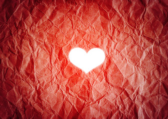 white heart shape on vibrant paper background