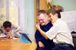 happy friends with disability socializing through internet - 78295544