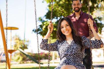 Couple having fun in a swing