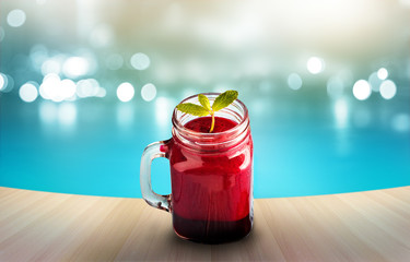 Beetroot smoothie healthy and mint herb on wooden and pool