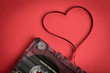 Audio cassette tape on red backgound. Film shaping heart