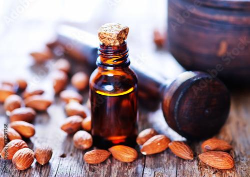 almond oil in a glass bottle - 78297168