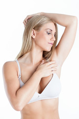 Woman looking on her armpit