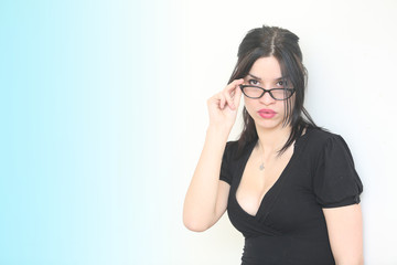 Beautiful sexy woman in eyeglasses with black suit