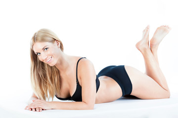 Smiling woman in black lingerie