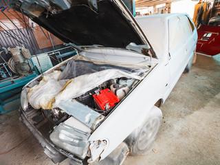 repairing of old car in country garage
