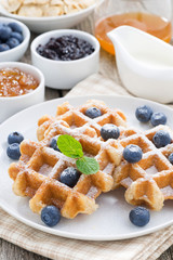 delicious waffles for breakfast, vertical
