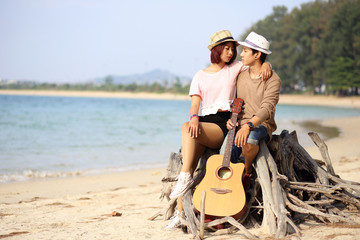 Asian couple by the sea in phuket thailand