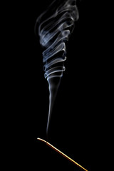 Burning incense on black background
