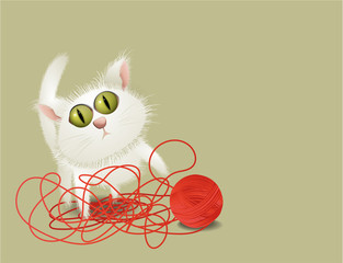 Little cat playing with ball of wool