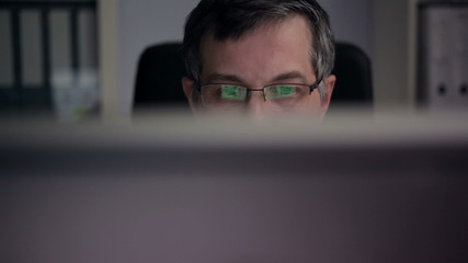 Businessman Works in front of his Computer