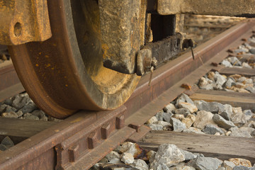 Details of rusty train wheel on track