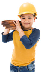 Young asian child construction Worker Holding equipment