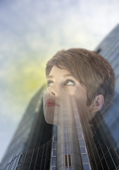Double exposure of business woman with office building
