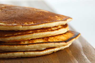 Fried pancakes on a wooden surface.