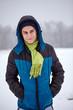 Teenage boy standing on a snowy field