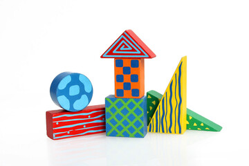 Colorful wooden toys on white background