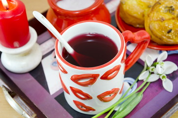 Lip patterned tea mug and corn bread closeup