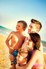 happy family having fun in the sea travel