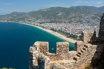 Castle of Alanya built on rocks and beach of Cleopatra,